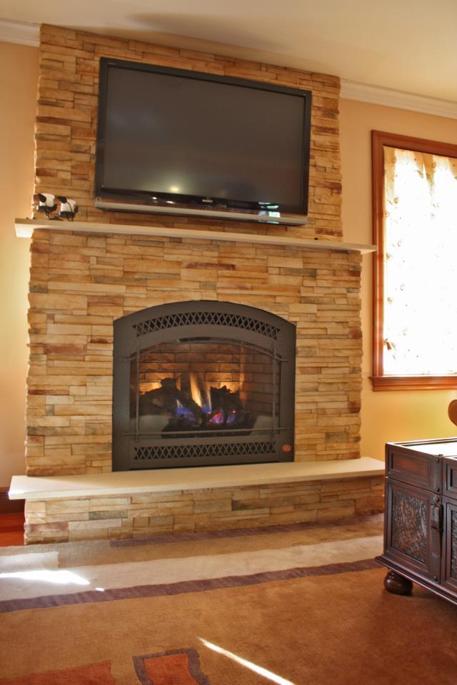 FireplaceX 864 w/ Cultured Stone Wall, Granite Shelf and Granite Step